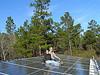 John S. Quarterman and Gretchen Quarterman with farm workshop solar panels at Okra Paradise Farms