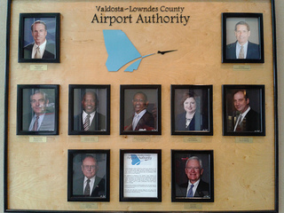 Pictures of authority members on the wall at the airport